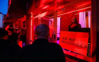 HAMBURG, GERMANY - JULY 11: Sex workers protest against lockdown measures that are preventing brothels from reopening in Hamburg's red light district during the coronavirus pandemic on July 11, 2020 in Hamburg, Germany. Sex workers across Germany are demanding an easing of ongoing lockdown measures that are preventing them from resuming their work. While authorities have lifted lockdown measures for most businesses in Germany, some, especially for those that involve close physical contact, remain in place. Legal sex workers say they are being treated unfairly, claiming they have developed adequate hygienic measures to prevent the spread of the virus and point out that other businesses that require similar physical proximity, such as hair salons and tattoo parlours, have been allowed to reopen. (Photo by Morris MacMatzen/Getty Images)
