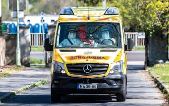 (FILES) In this file photo taken on April 12, 2020 Medics of the Hungarian Ambulance Service arrive to an elderly care home, where at least eight pensioners died due to the new coronavirus in Budapest. - A Budapest care home ravaged by the novel coronavirus has become a frontline in an escalating battle between Prime Minister Viktor Orban, emboldened by new emergency powers, and Hungary's beleaguered opposition. Orban and the Budapest municipality, run by a liberal mayor, blame each other for a COVID-19 outbreak that has infected at least 284 residents at the elderly care home operated by the capital. (Photo by GERGELY BOTAR / POOL / AFP) (Photo by GERGELY BOTAR/POOL/AFP via Getty Images)