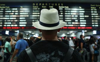 NEW YORK, NY - SEPTEMBER 02:  Large crowds rush to depart New York's Pennsylvania station before the start of the Labor Day holiday weekend on September 2, 2016 in New York City. Despite weather forecasts for high wind and rain from Hurricane Hermine, thousands of people departed Manhattan for the official last weekend of the summer.  (Photo by Spencer Platt/Getty Images)