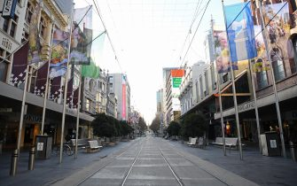 MELBOURNE, AUSTRALIA - JULY 13: An empty Bourke Street Mall is seen on July 13, 2020 in Melbourne, Australia. Metropolitan Melbourne and the Mitchell shire are in lockdown following the rise in COVID-19 cases through community transmissions. The new restrictions came into effect on Thursday 9 July, with residents in lockdown areas under stay at home orders for the next six weeks. People are only able to leave home have for exercise or work, to buy essential items including food or to access childcare and healthcare. Gatherings of groups of more than two or more than a household group are not permitted while school holidays have been extended by a week so children remain home. Retail can remain open and markets are permitted to open for food and drink only. Cafes, restaurants, pubs, clubs and bars are back to takeaway only. Eight public housing estates that have been under hard lockdown have reopened subject to stage 3 COVID-19 restrictions in line with the rest of Melbourne, while the tower at Alfred Street remains under hard lockdown while health authorities continue COVID-19 testing. (Photo by Quinn Rooney/Getty Images)