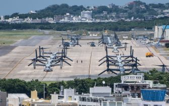GINOWAN, JAPAN - MAY 31: MV-22 Osprey aircraft sit on a runway at Marine Corps Air Station Futenma on May 31, 2018 in Ginowan, Okinawa prefecture, Japan. Demonstrators protesting against the U.S military presence on the southern Japanese island of Okinawa have staged continuous protests outside Camp Schwab to block construction vehicles as the camp is expanded to accommodate the relocation of an airbase in nearby Henoko. (Photo by Carl Court/Getty Images)