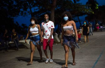 People walk along Santo Domingo's seafront, amid the COVID-19 novel coronavirus pandemic, on July 12, 2020. - The Dominican Republic reports 44,532 COVID-19 infections and 897 deaths so far, according to the National Public Health Service. (Photo by Erika SANTELICES / AFP) (Photo by ERIKA SANTELICES/afp/AFP via Getty Images)