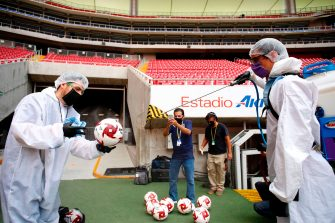 Footballs are sanitized before the Copa por Mexico pre-season football tournament match between Atlas and Tigres, at the Akron stadium in Zapopan, Metropolitan Guadalajara, Jalisco State, Mexico, on July 12, 2020, amid the COVID-19 novel coronavirus pandemic. - The tournament is played without spectators as a preventive measure against the spread of COVID-19. (Photo by Ulises RUIZ / AFP) (Photo by ULISES RUIZ/AFP via Getty Images)