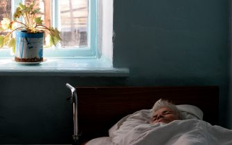 KOSTYRINO, RUSSIA - JANUARY 28: (RUSSIA OUT) A patient rests in bed in mental hospital number 2, January 28, 2008 in Kostyrino, Russia. The head doctor of the hospital uses art therapy as method of diagnostics, which helps  to understand patients state of health. (Photo by Oleg Klimov/Epsilon/Getty Images)