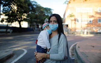 CARACAS, VENEZUELA - MARCH 14: A mother and her daughter wear medical masks before going to work on March 14, 2020 in Caracas, Venezuela. Delcy Rodriguez, Vice President of Venezuela, confirmed on Friday 13th the first two cases of COVID-19. President Nicolas Maduro had decreed a state of emergency in the health sector, suspended all flights from Europe and Colombia and mass public gatherings are banned. There is international concern about the management of the COVID-19 epidemic in Venezuela due to its collapsed health system. (Photo by Leonardo Fernandez Viloria/Getty Images)