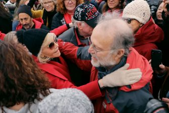 "WASHINGTON, DC - NOVEMBER 08: Actress Jane Fonda (L) embraces Jerry Greenfield of Ben and Jerry's ice cream maker at the conclusion of her ""Fire Drill Fridays"" rally protesting against climate change outside the White House November 08, 2019 in Washington, DC. The demonstrators temporarily blocked the White House northwest gate and said they were ready to be arrested. No one was arrested before they ended the protest and ate free ice cream.  (Photo by Chip Somodevilla/Getty Images)"