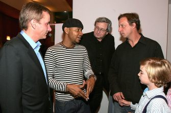 "LOS ANGELES, CA - OCTOBER 14:  (L-R)  Executive Director of Redcat Mark Murphy, Paul D. Miller a.k.a. DJ Spooky, President of CalArts Steven Levine and Tim Disney with his son Ciaran attends ""Rebirth Of A Nation"" Presented By Redcat at CalArts Downtown Center for Innovative Visual, Performing and Media Arts October 14, 2005 in Los Angeles, California. (Photo by Mark Mainz/Getty Images)"