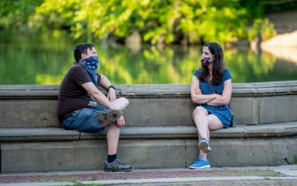 NEW YORK, NEW YORK - JULY 13: People sit at Bethesda Terrace in Central Park as New Yorkers adjust to the new realities of phase 3 of reopening on July 13, 2020 in New York, New York. Phase 3 permits the reopening of nail and tanning salons, tattoo parlors, spas and massages, dog runs and numerous other outdoor activities. Phase 3 is the third of four-phased stages designated by the state. (Photo by Roy Rochlin/Getty Images)