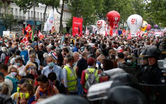 Protesters take part in a demonstration in Paris, on July 14, 2020, as part of a nationwide day of protests by health workers to demand better work conditions. - Health care workers are protesting in France on the country's National day to demand more for their sector a day after the government and unions signed an agreement giving over eight billion euros in pay rises, with the prime minister admitting the move was overdue in view of the coronavirus pandemic. (Photo by Zakaria ABDELKAFI / AFP) (Photo by ZAKARIA ABDELKAFI/AFP via Getty Images)