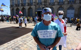 Health care workers demonstrate in Bordeaux on July 14, 2020, against the wage agreements as part of the 'Segur de la Sante' (general talks on Health reforms) aimed at improving working conditions, salaries and patient care in the medical sector. - Health care workers are protesting in France on the country's National day to demand more for their sector a day after the government and unions signed an agreement giving over eight billion euros in pay rises, with the prime minister admitting the move was overdue in view of the coronavirus pandemic. (Photo by MEHDI FEDOUACH / AFP) (Photo by MEHDI FEDOUACH/AFP via Getty Images)