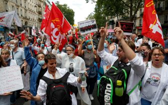 Protesters dance during a demonstration in Paris, on July 14, 2020, as part of a nationwide day of protests by health workers to demand better work conditions. - Health care workers are protesting in France on the country's National day to demand more for their sector a day after the government and unions signed an agreement giving over eight billion euros in pay rises, with the prime minister admitting the move was overdue in view of the coronavirus pandemic. (Photo by Zakaria ABDELKAFI / AFP) (Photo by ZAKARIA ABDELKAFI/AFP via Getty Images)