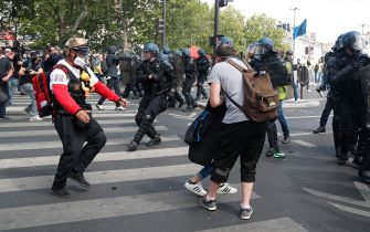 French gendarmes disperse protesters during a demonstration in Paris, on July 14, 2020, as part of a nationwide day of protests by health workers to demand better work conditions. - Health care workers are protesting in France on the country's National day to demand more for their sector a day after the government and unions signed an agreement giving over eight billion euros in pay rises, with the prime minister admitting the move was overdue in view of the coronavirus pandemic. (Photo by Zakaria ABDELKAFI / AFP) (Photo by ZAKARIA ABDELKAFI/AFP via Getty Images)
