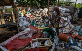 NEW DELHI, INDIA - JULY 14: Indian ragpickers separate valuable items which they collected from a garbage dump  on July 14, 2020  in New Delhi, India.  With over 900,000 confirmed cases and 23,000 deaths, environmental and health experts have warned that India, which is currently the third worst COVID19-affected country, could face further challenges in tackling the impact of the global pandemic if immediate steps are not taken for the proper disposal of masks, gloves, personal protective equipment and other waste materials. (Photo by Yawar Nazir/Getty Images)