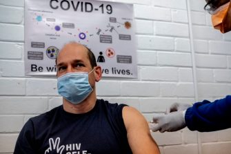 Professor Francois Venter (L) receives an experimental vaccine for COVID-19 coronavirus at the Respiratory & Meningeal Pathogens Research Unit (RMPRU) at Chris Hani Baragwanath Hospital in Soweto, on July 14, 2020. - Six senior clinicians in the Faculty of Health Sciences at Wits University have volunteered to participate in South Africas first COVID-19 vaccine trial. (Photo by Luca Sola / AFP) (Photo by LUCA SOLA/AFP via Getty Images)