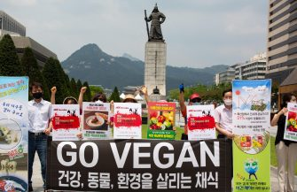 epa08548864 Members of the Vegan in Korea activist group hold placards and shout slogans during a protest against eating dog meat, at Gwanghwamun Square in Seoul, South Korea, 16 July 2020. The protesters voiced their objection to eating dog meat and call for the government to enact a law prohibiting dog-meat consumption.  EPA/JEON HEON-KYUN