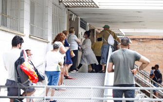 epa08549573 Resident wait in a queue outside a primary care center in the district of La Florida, in the city of L'Hospitalet, near Barcelona, Spain, 16 July 2020. Catalan authorities carried out several special measures to avoid the spreading of the virus after a COVID-19 outbreak were registered in three suburbs of L'Hospitalet, the second most populated city of Catalonia.  EPA/Alejandro Garcia