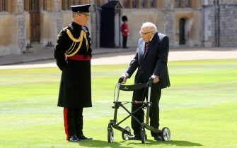 100-year-old WWII veteran Captain Tom Moore attends an investiture where he will be made a Knight Bachelor during at Windsor Castle in Windsor, west of London on July 17, 2020. - British World War II veteran Captain Tom Moore was made a a Knight Bachelor (Knighthood) for raising over £32 million for the NHS during the coronavirus pandemic. (Photo by Chris Jackson / POOL / AFP) (Photo by CHRIS JACKSON/POOL/AFP via Getty Images)