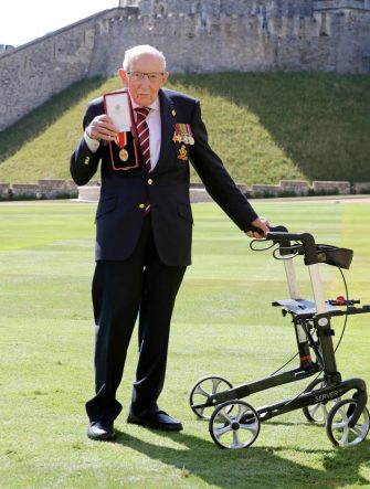 WINDSOR, ENGLAND - JULY 17: Captain Sir Thomas Moore poses after being awarded with the insignia of Knight Bachelor by Queen Elizabeth II at Windsor Castle on July 17, 2020 in Windsor, England. British World War II veteran Captain Tom Moore raised over £32 million for the NHS during the coronavirus pandemic.  (Photo by Chris Jackson/Getty Images)