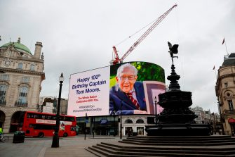 A birthday message for Captain Tom Moore is displayed on the advertising boards in Piccadilly Circus in London on April 30, 2020 as the country celebrates his 100th birthday. (Photo by Tolga Akmen / AFP) (Photo by TOLGA AKMEN/AFP via Getty Images)