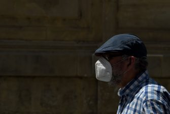 A man wearing a face mask walks in Lerida (Lleida) on July 13, 2020. - A local court suspended a home confinement order imposed on more than 200,000 people in the Spanish region of Catalonia after an upsurge in virus cases. Catalonia officials ordered the home confinement on the city of Lerida and its surrounding areas a week after the zone had been placed under less strict lockdown. (Photo by Pau BARRENA / AFP) (Photo by PAU BARRENA/AFP via Getty Images)