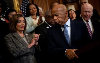Speaker of the House Nancy Pelosi (D-CA) and others clap for Rep. John Lewis (D-GA) during a press conference about voting rights on Capitol Hill December 6, 2019, in Washington, DC. (Photo by Brendan Smialowski / AFP) (Photo by BRENDAN SMIALOWSKI/AFP via Getty Images)
