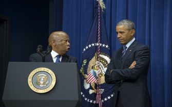 US President Barack Obama (R) listens as US Congressman John Lewis , D-Georgia, delivers remarks marking the 50th anniversary of the Voting Rights Act in Washington, DC, August 6, 2015.         AFP PHOTO/JIM WATSON        (Photo credit should read JIM WATSON/AFP via Getty Images)