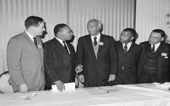 """(Original Caption) 11/17/1965-Washington, DC: Veteran Negro leader A. Philip Randolph launched the White House Conference on Civil Rights with a call for $100 billion """"Freedom Budget"""" tp wipe out black ghettos in U.S. Cities. Randolph and other Civil Rights Leaders are taking part in the conference. Here at the start of the conference are (Left to Right): Morris B. Abram, Co-Chiarman of the conference; the Rev. Martin Luther King; Randolph; John Lewis, Head of the Students for Non-violent Action; and William T. Coleman, another Co-Chairman."""