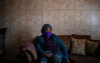 Pensioner Lina Moremi, 70, sits on her couch waiting for the food parcel distributed by Meals on Wheels in Tsakane, Ekurhuleni, on July 6, 2020. - As Gauteng province's COVID-19 coronavirus infection rate soared to 63 404 positive cases on Sunday 5 July, Meals on Wheels South Africa continues preparing and delivering meals and food parcels to those in need in urban and rural communities. (Photo by Michele Spatari / AFP) (Photo by MICHELE SPATARI/AFP via Getty Images)