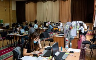 Medics and medical students work at a coronavirus disease call centre in Bishkek on July 5, 2020. (Photo by DANIL USMANOV / AFP) (Photo by DANIL USMANOV/AFP via Getty Images)