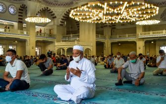 Kyrgyz Muslims wearing face masks and keeping a social distance of 1.5 meters pray in the Central Imam Serahsi Mosque in Bishkek on June 12, 2020, amid the COVID-19 coronavirus pandemic. - Mosques are opened for prayer after restrictions on the coronavirus epidemic (COVID-19) began to loosen in Kyrgyzstan. (Photo by VYACHESLAV OSELEDKO / AFP) (Photo by VYACHESLAV OSELEDKO/AFP via Getty Images)