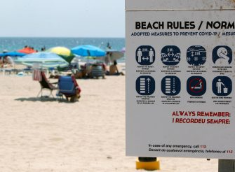 epa08556382 A sign informs beachgoers of the new beach rules on a beach in the coastal town of Finestrat, Alicante, eastern Spain, 20 July 2020. Local authorities banned smoking on beaches with fines from 600 to 1,200 euros amid the ongoing pandemic of the COVID-19 disease caused by the SARS-CoV-2 coronavirus, reports state.  EPA/MORELL