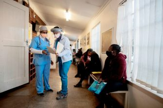Doctors (L) stand at the Respiratory & Meningeal Pathogens Research Unit (RMPRU) at the Chris Hani Baragwanath Hospital in Soweto on July 14, 2020. - Six senior clinicians in the Faculty of Health Sciences at Wits University have volunteered to participate in South Africas first COVID-19 vaccine trial. (Photo by Luca Sola / AFP) (Photo by LUCA SOLA/AFP via Getty Images)