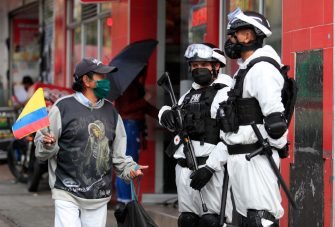 BOGOTA, COLOMBIA - JULY 19: Soldiers wearing a biological protective suites stand guard on a main street on July 19, 2020 in Bogota, Colombia. According to World Health Organization, Colombia has registered over 190,700 positive cases of Coronavirus (COVID-19) and more than 6,500 deaths. (Photo by VIEW press/Getty Images)
