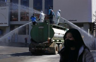 Municipal workers disinfect the main streets of Puno, in the highlands of Peru close to the border with Bolivia, on July 17, 2020 due to an increase of COVID-19 cases - Peru's government has come under heavy criticism for its management of the health crisis, which has left 333,000 people infected, the second most in Latin America, and more than 12,00 dead -- the third highest toll in the region. (Photo by Carlos MAMANI / AFP) (Photo by CARLOS MAMANI/AFP via Getty Images)