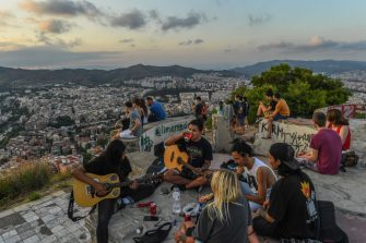 BARCELONA, SPAIN - JULY 18: A group of friends play guitars and have drinks as they enjoy the view over the city during the first day the new Catalan government recommendations and regulations on the fight against COVID-19 take effect on July 18, 2020 in Barcelona, Spain. The Catalan capital's five million residents have been advised to stay home after the number of Coronavirus cases spiked in the past week. (Photo by David Ramos/Getty Images)