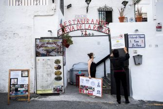 GRANADA, SPAIN - JULY 18: Rocío and Diego, workers of the flamenco tablao 'La Cueva de la Rocío', post informative panels as a security measure due to the threat of the coronavirus on July 18, 2020 in Granada, Spain. The tablao flamenco 'La Cueva de la Rocio' reopened its doors on July 1st, 2020, after more than 3 months closed due to the Coronavirus pandemic. Security measures only allow 65 percent of capacity, and they are mostly national tourists.  (Photo by Carlos Gil/Getty Images)