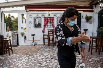 GRANADA, SPAIN - JULY 18: Flamenco dancer Ivan Vargas wearing a protective mask dances on the terrace of the flamenco tablao 'La Cueva de la Rocio' just before a show on July 18, 2020 in Granada, Spain. The tablao flamenco 'La Cueva de la Rocio' reopened its doors on July 1st, 2020, after more than 3 months closed due to the Coronavirus pandemic. Security measures only allow 65 percent of capacity, and they are mostly national tourists.  (Photo by Carlos Gil/Getty Images)