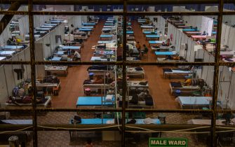 NEW DELHI, INDIA - JULY 17: Indian Covid-19 patients rest on beds  at an indoor sports stadium, temporarily been converted into an emergency Covid 19 care center on July 17, 2020  in New Delhi, India. With the highest single-day surge of 34,956 cases, Indias confirmed Covid-19 infections crossed the 1 million mark as the worlds third worst hit country grapples to deal with the impact of the global epidemic. Even as death toll due to the deadly virus mounted to 25,602 with record 687 fatalities in a day, according to data released by the health ministry on early Friday, Indian Prime Minister Narendara Modi in a televised address said the country was ensuring one of the best recovery rates in the world in its fight against Covid-19. (Photo by Yawar Nazir/Getty Images)