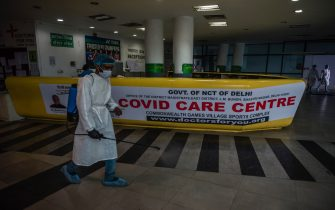 NEW DELHI, INDIA - JULY 17: An Indian health worker sprays disinfectant in an indoor sports stadium, temporarily been converted into an emergency Covid 19 care center on July 17, 2020  in New Delhi, India. With the highest single-day surge of 34,956 cases, Indias confirmed Covid-19 infections crossed the 1 million mark as the worlds third worst hit country grapples to deal with the impact of the global epidemic. Even as death toll due to the deadly virus mounted to 25,602 with record 687 fatalities in a day, according to data released by the health ministry on early Friday, Indian Prime Minister Narendara Modi in a televised address said the country was ensuring one of the best recovery rates in the world in its fight against Covid-19. (Photo by Yawar Nazir/Getty Images)
