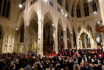 NEW YORK, NY - SEPTEMBER 24: Guests take photos as Pope Francis arrives at Saint Patrick's Cathedral to lead evening Vespers on September 24, 2015 in New York City. The pope is on a six-day visit to the U.S., with stops in Washington, New York City and Philadelphia. (Photo by Robert Deutsch-Pool/Getty Images)
