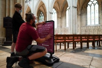 YORK, UNITED KINGDOM - JUNE 15: Staff prepare signage as York Minster prepares to welcome people back for individual prayer on June 16 following the recent government announcement that places of worship can reopen for this form of worship on June 15, 2020 in York, United Kingdom. The cathedral is initially planning to open its main Nave area for people to visit the sacred space, light a candle, reflect and pray. Measures are being put in place to help keep people safe while visiting the cathedral, including limiting the number of people allowed inside at any one time, reduced seating, a new one-way system and hand sanitizer points. The cathedral will remain closed for public worship and sightseeing, in line with government guidance. As the British government further relaxes Covid-19 lockdown measures in England, this week sees preparations being made to open non-essential stores, travellers will be required to wear face coverings on public transport and international travellers arriving in the UK will face a 14-day quarantine period. (Photo by Ian Forsyth/Getty Images)