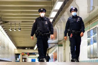 NEW YORK, NEW YORK - MAY 06: NYPD officers patrol inside Times Square station as the New York City subway system, the largest public transportation system in the nation is set for nightly cleaning due to the continued spread of the coronavirus on May 06, 2020 in New York City. Following reports of homeless New Yorkers sleeping on the trains and the deaths of numerous subway employees, the Metropolitan Transportation Authority has decided to close New Yorks subway system from 1am to 5am every evening for a deep cleaning. New York continues to be the national center of the COVID-19 outbreak.(Photo by Eduardo Munoz Alvarez/Getty Images)