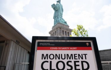 NEW YORK, NY - JULY 20: A closed sign is posted in front of the Statue of Liberty as Liberty Island reopened on July 20, 2020 in New York City. Liberty Island is partially reopening months after the attraction was shut down due to the coronavirus pandemic. Access to Liberty Island has reopened but the statue itself, the pedestal and museum remain closed. (Photo by Jeenah Moon/Getty Images)
