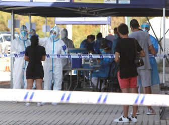 epa08558096 Several paramedics test young people, who attended a disco's party for COVID-19, at a tent in the coastal town of Santa Pola, eastern Spain, 21 July 2020. The local health authorities are testing people attended Oasis Disco on 10,11 and 12 July due to a coronavirus outbreak.  EPA/MORELL