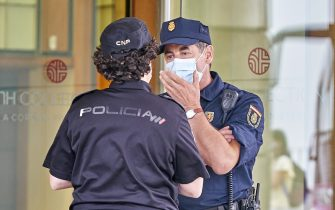 LA CORUNA, SPAIN - JULY 20:  Two policemen speak outside the  Hotel Finisterre place where the CF Fuenlabrada players who have tested positive for Covid-19 are staying, before the La Liga Smartbank match between RC Deportivo and CF Fuenlabrada at Estadio Abanca Riazor on July 20, 2020 in La Coruna, Spain. (Photo by Jose Manuel Alvarez/Quality Sport Images/Getty Images)