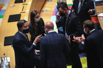 Dutch Prime Minister Mark Rutte (L), Finnish Prime Minister Sanna Marin (2nd L), European Council President Charles Michel (C), Spanish Prime Minister Pedro Sanchez (2nd R) and French President Emmanuel Macron (R), attend a round table meeting at an EU summit over a post-virus economic rescue plan in Brussels, on July 20, 2020. - EU leaders were gathered for a fourth day on July 20 during a summit to try to unblock a multi-billion-euro bundle of loans and direct aid to drag Europe out of the recession caused by the pandemic. (Photo by Francisco Seco / POOL / AFP) (Photo by FRANCISCO SECO/POOL/AFP via Getty Images)