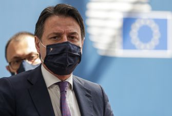 Italy's Prime Minister Giuseppe Conte, wearing a protective face mask, arrives for the fourth day of an EU summit at the European Council building in Brussels, on July 20, 2020, as the leaders of the European Union hold their first face-to-face summit over a post-virus economic rescue plan. - The 27 EU leaders gather for another session of talks after three days and nights of prolonged wrangling failed to agree a 750-billion-euro ($860-billion) bundle of loans and grants to drag Europe out of the recession caused by the coronavirus pandemic (COVID-19). (Photo by STEPHANIE LECOCQ / POOL / AFP) (Photo by STEPHANIE LECOCQ/POOL/AFP via Getty Images)