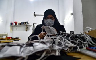 An Algerian volunteer from a sewing workshop makes face masks to help fight the novel coronavirus pandemic, in the capital Algiers, on June 4, 2020. (Photo by RYAD KRAMDI / AFP) (Photo by RYAD KRAMDI/AFP via Getty Images)