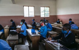 Students wear face masks as a preventive measure against the spread of the COVID-19 coronavirus in their classroom at the  Jean Benoit College in Yaoundé, Cameroon, on June 1, 2020. - Cameroon's schools and universities reopened on Monday as the government was criticised over weak measures to combat the spread of coronavirus in one of the worst-affected countries in sub-Saharan Africa. The government suspended classes in mid-March for universities and schools at all grade levels, both public and private. (Photo by - / AFP) (Photo by -/AFP via Getty Images)