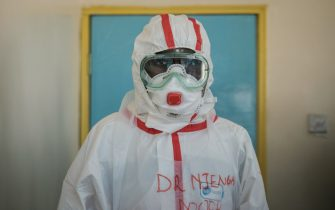 A doctor gets ready with protective gears before visiting the ward for quarantined people who had close contacts with the first Kenyan patient of the COVID-19 at the Infectious Disease Unit of Kenyatta National Hospital in Nairobi, Kenya, on March 15, 2020, during the COVID-19 outbreak, caused by the novel coronavirus. - Kenya announced on March 13, 2020, the first confirmed case of coronavirus in East Africa, as the region so far unscathed by the global pandemic scaled up emergency measures to contain its spread. A 27-year-old Kenyan woman tested positive for the virus on March 12 in Nairobi, a week after returning from the United States via London. (Photo by Yasuyoshi CHIBA / AFP) (Photo by YASUYOSHI CHIBA/AFP via Getty Images)